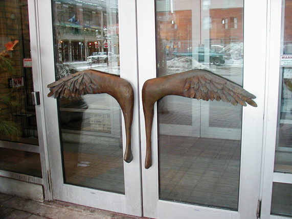 photo of door handles like wings by Ingrid Cryns