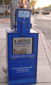 Photo of Toronto Star street sales box with Mary Hynes on front page visible, July 29, 2011